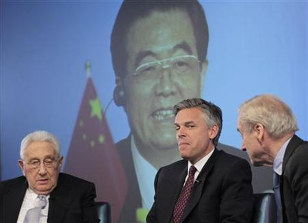 Former Utah Governor Jon Huntsman (C) speaks about China on a panel event with Henry Kissinger (L) and Sir Harry Evans (R) hosted by Thomson Reuters in New York, June 14, 2011. REUTERS/Brendan McDermid
