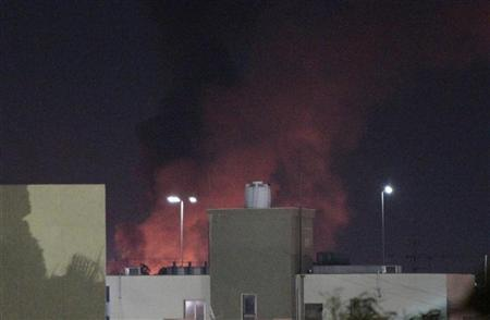 Smoke and fire are seen after coalition air strikes, in Tripoli June 14, 2011. REUTERS/Ahmed Jadallah