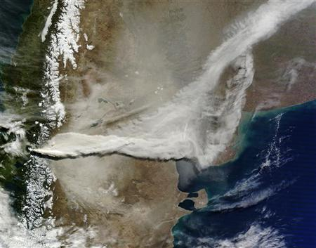 In this handout image provided by NASA, The MODIS instrument on NASA's Terra satellite captured a visible image of the ash plume from the eruption of a volcano in Chile's Puyehue-Cordon Caulle chain, June 13 ,2011. REUTERS/NASA Goddard/MODIS Rapid Response, Jeff Schmaltz/Handout