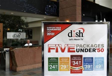 An advertising sign in the lobby of the corporate headquarters of Dish Network shows current packages in the Denver suburb of Englewood, Colorado April 6, 2011. REUTERS/Rick Wilking