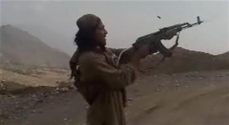 In this undated image taken from a video recording provided by the Pakistan Taliban, a man fires a weapon into the air in an undisclosed location in Pakistan's northwest tribal region. REUTERS/Handout