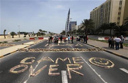 Anti-government protesters form the words ''Game Over'' with bricks as they block the roads from riot police at the junction of Bahrain Financial Harbour in Manama March 14, 2011. REUTERS/Hamad I Mohammed