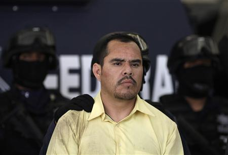 Suspected crime boss Marco Antonio Guzman Zuniga, alias ''El Brad Pitt'', is presented to the media by the Federal Police in Mexico City June 16, 2011. REUTERS/Jorge Dan Lopez