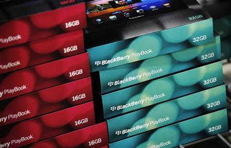 Boxes of RIM PlayBooks are seen on a shelf in Toronto, April 19, 2011. REUTERS/Mark Blinch