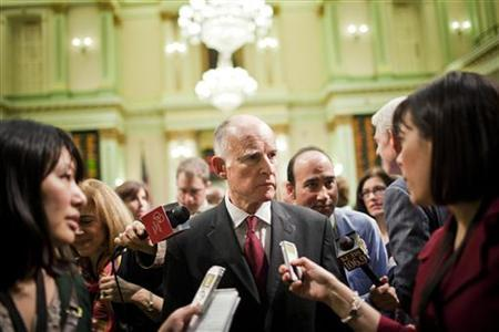 California Governor Jerry Brown speaks to reporters after delivering the State of the State address in Sacramento, California January 31, 2011. REUTERS/Max Whittaker