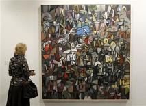 <p>A woman looks at an untitled painting from 2011 by U.S.artist George Condo at the Art Basel art fair in Basel June 16, 2011. REUTERS/Arnd Wiegmann</p>