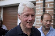 <p>Bill Clinton is escorted to a craft shop by his aides before the start of the ThisDay annual awards for Excellence and Good Governance at Eko Hotel in Nigeria's commercial capital Lagos March 25, 2011. REUTERS/Joseph Penney</p>