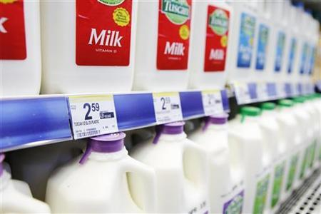 Price labels of half gallons of milk for sale are seen in a store in New York April 7, 2011. REUTERS/Lucas Jackson