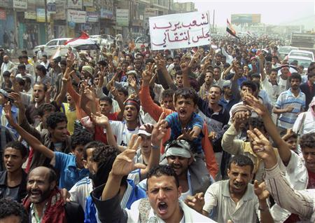 Anti-government protesters shout slogans during a demonstration to demand the ouster of Yemen's President Ali Abdullah Saleh in the Damt town of the southern Dhalea province June 20, 2011. The banner reads: ''The people want a transitional council.'' REUTERS/Stringer