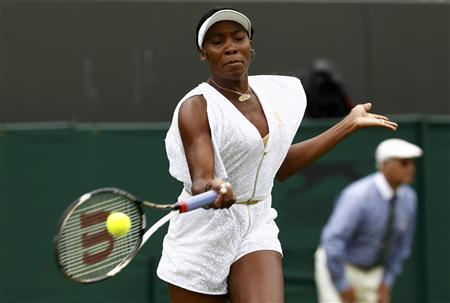 Venus Williams of the U.S. hits a return to Akgul Amanmuradova of Uzbekistan at the Wimbledon tennis championships in London, June 20, 2011. REUTERS/Eddie Keogh