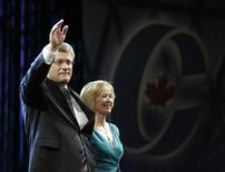 <p>Canada's Prime Minister Stephen Harper arrives on stage with his wife Laureen Harper to speak at the Conservative Party convention in Ottawa June 10, 2011. REUTERS/Patrick Doyle</p>