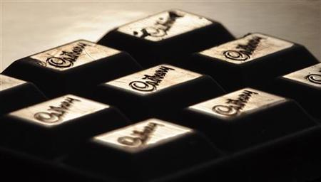The Cadburys logo is seen on a bar of chocolate December 14, 2009. REUTERS/Toby Melville