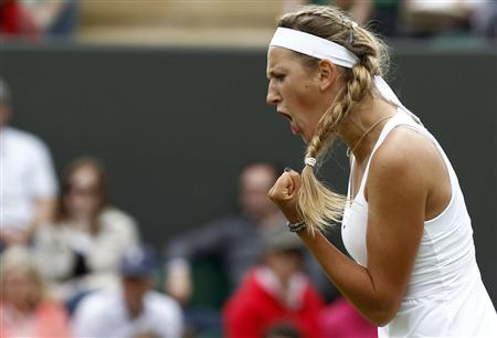 Victoria Azarenka of Belarus reacts during her match against Magdalena Rybarikova of Slovakia at the Wimbledon tennis championships in London June 20, 2011. REUTERS/Eddie Keogh