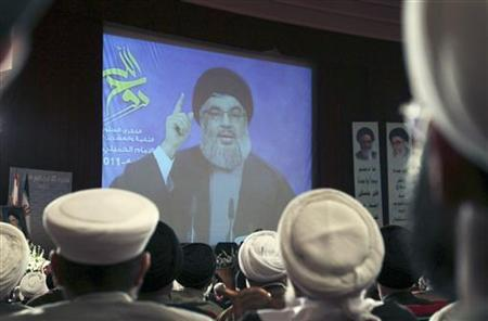 Lebanon's Hezbollah leader Sayyed Hassan Nasrallah speaks via video screen during a ceremony marking the 22nd anniversary of the death of the founder of the Islamic Republic Ayatollah Ruhollah Khomeini, in Beirut June 1, 2011. REUTERS/ Mohamed Azakir