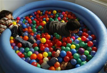 Autistic children play at the Consulting Centre for Autism in Amman, March 30, 2010, one of the few places in the country that helps children with the condition. The world will mark World Autism Awareness Day on April 2. REUTERS/Ali Jarekji