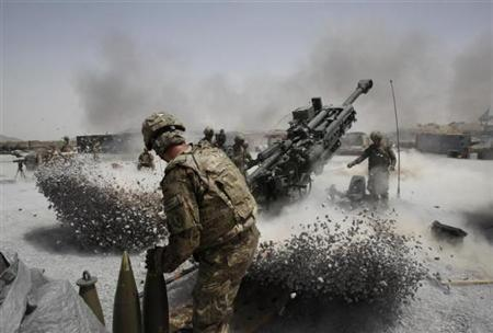 U.S. Army soldiers from the 2nd Platoon, B battery 2-8 field artillery, fire a howitzer artillery piece at Seprwan Ghar forward fire base in Panjwai district, Kandahar province, southern Afghanistan, June 12, 2011. REUTERS/Baz Ratner