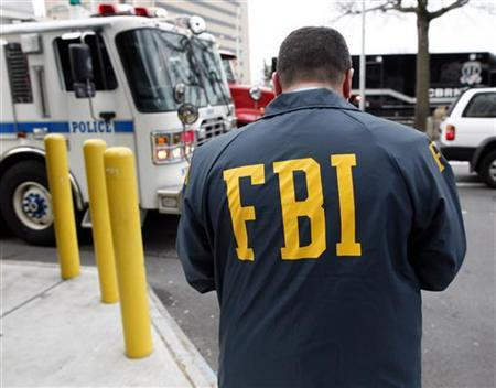 An FBI Special Agent is seen in Queens, New York March 25, 2010. REUTERS/Chip East