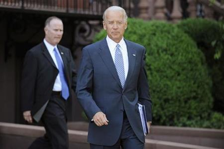 Vice President Joe Biden departs after meeting with a bipartisan group of lawmakers to work on a legislative framework for comprehensive deficit reduction at the Blair House in Washington May 10, 2011. REUTERS/Jonathan Ernst
