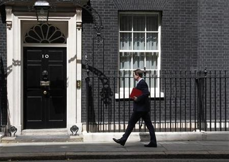 Deputy Prime Minister Nick Clegg arrives at 10 Downing Street, in central London May 24, 2011. REUTERS/Phil Noble
