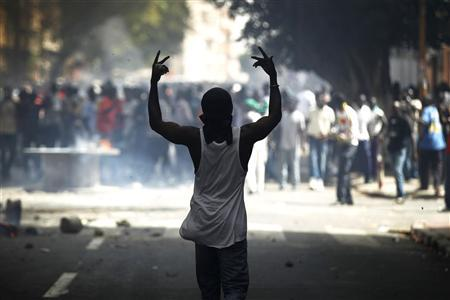 A protester gestures during a violent demonstration in Senegal's capital Dakar June 23, 2011. REUTERS/Finbarr O'Reilly