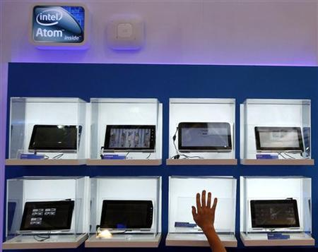 A man touches a display box at the Intel booth during the Computex 2011 computer fair at the TWTC Nangang exhibition hall in Taipei May 31, 2011. REUTERS/Pichi Chuang