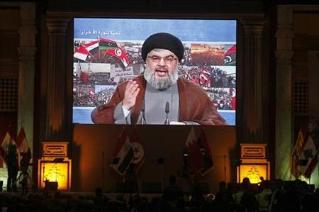 Lebanon's Hezbollah leader Sayyed Hassan Nasrallah addresses his supporters through a giant screen to express solidarity with the Arab uprisings and in support of their sacrifices, during a rally in Beirut's suburb, March 19, 2011. REUTERS/ Sharif Karim