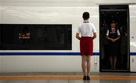 A conductor stands in a new high-speed train before it departs from the Beijing-South railway station for Shanghai as part of an official trip for members of the media June 27, 2011. REUTERS/David Gray