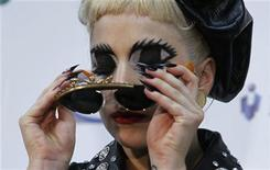 <p>Lady Gaga takes off her sunglass during a news conference after performing at the MTV Video Music Aid Japan in Chiba, near Tokyo, June 25, 2011. REUTERS/Toru Hanai</p>