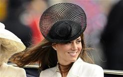 <p>Britain's Catherine, Duchess of Cambridge smiles as she rides to Buckingham Palace after attending the Trooping the Colour ceremony in central London June 11, 2011. REUTERS/Dylan Martinez</p>