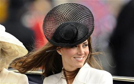 Britain's Catherine, Duchess of Cambridge smiles as she rides to Buckingham Palace after attending the Trooping the Colour ceremony in central London June 11, 2011. REUTERS/Dylan Martinez