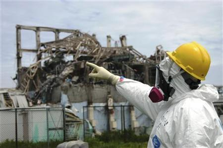 International Atomic Energy Agency fact-finding team leader Mike Weightman examines Reactor Unit 3 at the Fukushima Daiichi Nuclear Power Plant, May 27, 2011. REUTERS/IAEA