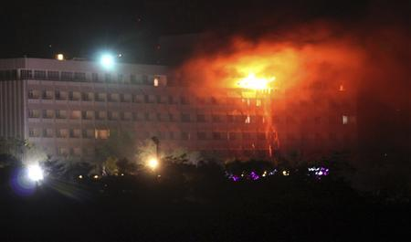 Smoke and flames rise from the Intercontinental hotel during a battle between NATO-led forces and suicide bombers and Taliban insurgents in Kabul June 29, 2011. REUTERS/Stringer