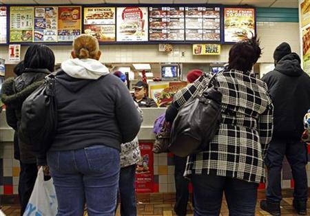 People line up to buy food at a fast food restaurant in Harlem in New York December 16, 2009. REUTERS/Finbarr O'Reilly