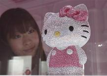 "<p>A woman looks at a Hello Kitty figurine, studded with a total of 19,636 Swarovski crystals, during a press preview of Swarovski's Hello Kitty collection at an event entitled ""House of Hello Kitty"" in Tokyo on June 29, 2011. The figurine, limited to 88, will be on sale worldwide with a price tag of 1,155,000 yen ($14,246). REUTERS/Yuriko Nakao</p>"
