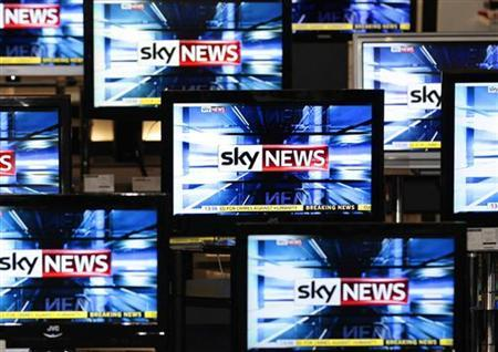 The Sky News logo is seen on television screens in an electrical store in Edinburgh, March 3, 2011. Rupert Murdoch's News Corp took a huge step towards securing its prized $14 billion buyout of BSkyB on Thursday when Britain accepted its proposals to alleviate competition concerns. REUTERS/David Moir