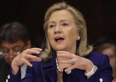 Secretary of State Hillary Clinton gestures as she testifies before the Senate Foreign Relations Committee hearing on Evaluating Goals and Progress in Afghanistan and Pakistan on Capitol Hill, June 23, 2011. REUTERS/Yuri Gripas