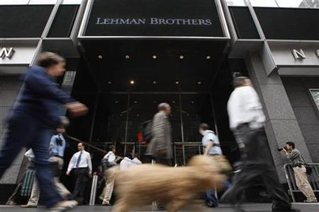 People walk past the Lehman Brothers headquarters in New York, in this September 16, 2008 file photo. REUTERS/Chip East