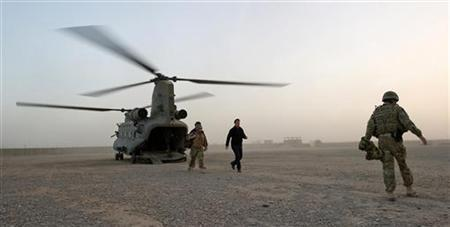Britain's Prime Minister David Cameron (C) arrives at the Helmand Police training centre December 6, 2010. REUTERS/Leon Neal/Pool