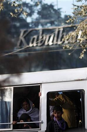 A local bus passes in front of a branch of the Kabulbank in Kabul September 14, 2010. REUTERS/Andrew Biraj