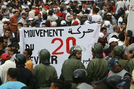 Police face protesters pushing for democratic reforms during a rally organised by the country's so-called ''February 20'' street movement in Morocco's main economic hub Casablanca July 3, 2011. REUTERS/Macao