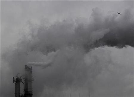 Smoke billows from chimneys at an industrial district near Tokyo February 28, 2011. REUTERS/Kim Kyung-Hoon