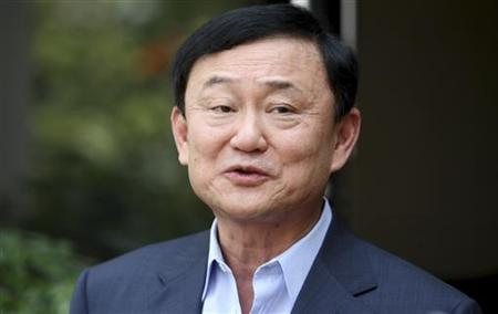 Thailand's former premier Thaksin Shinawatra speaks to journalists outside his home in Dubai, after Puea Thai Party's Yingluck Shinawatra announced her coalition in Bangkok July 4, 2011. REUTERS/Jumana El Heloueh