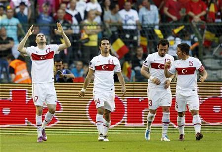 Turkey's players celebrate after scoring against Belgium during their Euro 2012 Group A qualifying football match at King Baudouin Stadium in Brussels June 3, 2011. REUTERS/Yves Herman