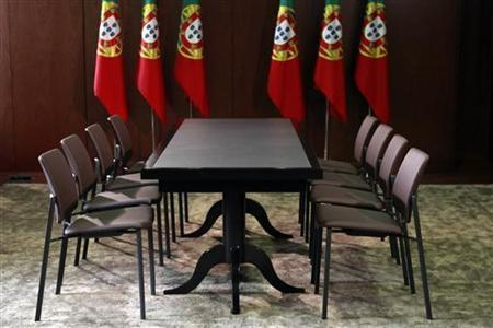 Portuguese flags are seen on the meeting room in Lisbon June 16, 2011. REUTERS/Jose Manuel Ribeiro