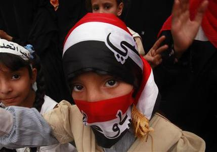 A girl covers her face with a Yemen flag during a demonstration to demand the ouster of Yemen's President Ali Abdullah Saleh at Tagheer square in Sanaa July 5, 2011. REUTERS/Suhaib Salem