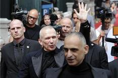 <p>French designer Jean-Paul Gaultier (C) waves as he walks outside after his Haute Couture Fall-Winter 2011/2012 fashion show in Paris July 6, 2011. REUTERS/Gonzalo Fuentes</p>