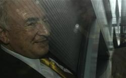 <p>Former International Monetary Fund (IMF) chief Dominique Strauss-Kahn is seen smiling through a car window as he departs his lawyer's office in New York July 6, 2011. REUTERS/Brendan McDermid</p>