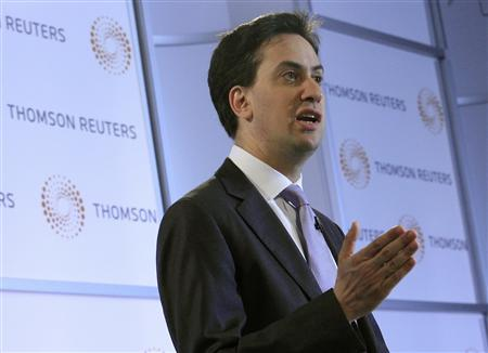 Labour leader, Ed Miliband, delivers his speech at the offices of Thomson Reuters in the Canary Wharf district of London July 8, 2011. REUTERS/Luke MacGregor