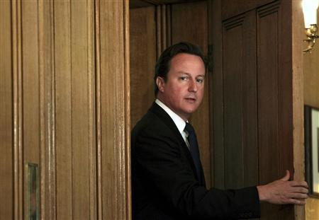 Prime Minister David Cameron arrives to give a news conference at number 10 Downing Street in London July 8, 2011. REUTERS/Peter Macdiarmid/pool