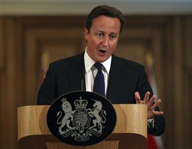 Britain's Prime Minister David Cameron speaks during a news conference at number 10 Downing Street in London July 8, 2011. Cameron said on Friday he believed that his former communications chief Andy Coulson was being investigated over allegations of phone hacking during his time as editor of the News of the World. REUTERS/Peter Macdiarmid/pool
